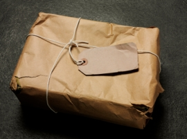Box wrapped in brown paper with blank label